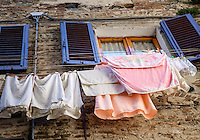 SAN GIMIGNANO, ITALY - CIRCA MAY 2015:  Typical windows and garment hangers  in San Gimignano in Tuscany