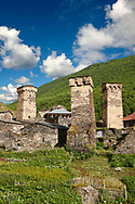 Stone medieval Svaneti tower houses of Chazhashi, Ushguli, Upper Svaneti, Samegrelo-Zemo Svaneti, Mestia, Georgia. Chazhashi is the main village of a group of four remote villages known collectively as Ushguli. At 2,200 m (7217 ft) above sea level in the Caucasus mountains these are the highest inhabited villages in Europe. Chazhashi has 13 well preserved stone Svanetian defensive tower houses attached to stone family houses. A UNESCO World Heritage Site. .<br /> <br /> Visit our REPUBLIC of GEORGIA HISTORIC PLACES PHOTO COLLECTIONS for more photos to browse, download or buy as wall art prints https://funkystock.photoshelter.com/gallery-collection/Pictures-Images-of-Georgia-Country-Historic-Landmark-Places-Museum-Antiquities/C0000c1oD9eVkh9c