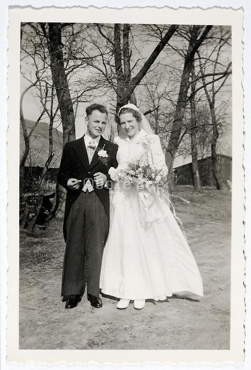 vintage formal portrait of just married couple Netherlands 1950s