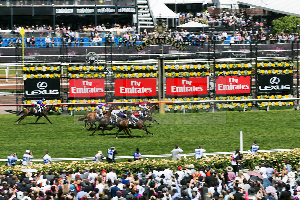 © Licensed to London News Pictures. 5/11/2013. Spectators cheering the horses on as they approach the finish line in Race 6 during Melbourne Cup Day at Flemington Racecourse on November 5, 2013 in Melbourne, Australia. Photo credit : Asanka Brendon Ratnayake/LNP