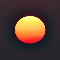 Sunset over the Pacific Ocean. There are two sunspots visible. Image taken with a Nikon N1V3 camera and 70-300 mm VR lens (ISO 160, 300 mm, f/8, 1/500 sec).