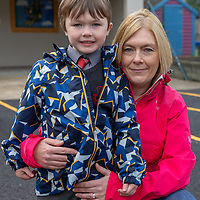 Darragh O'Donnellan with his his mother Christina on his first day at Crusheen National School on Wednesday