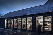 wine shop exterior suffolk england uk dusk