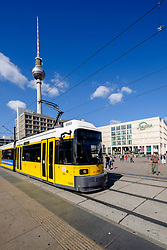 View of Alexanderplatz with yellow tram in Mitte Berlin Germany