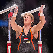 Epke Zonderland of the Netherlands apple chalk before he performs on the Parallel Bars at the 46th FIG Artistic Gymnastics World Championships in Glasgow, Britain, 25 October 2015.