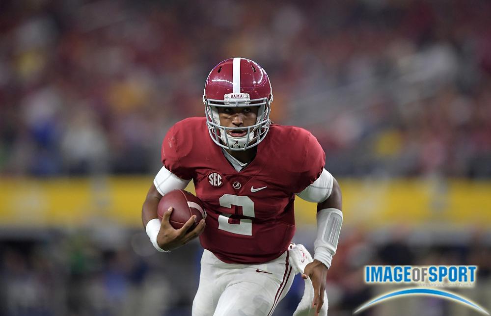 Sep 3, 2016; Arlington, TX, USA; Alabama Crimson Tide quarterback Jalen Hurts (2) carries the ball against the USC Trojans during a NCAA football game at AT&T Stadium. Alabama defeated USC 52-6.
