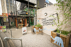 Built from repurposed shipping containers, The Artworks' Elephant revitalises underused properties by transforming them into creative workspaces and social hubs. Elephant & Castle, London Borough of Southwark, UK 2017