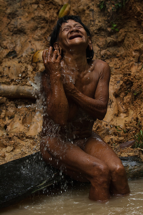 Huaorani Indian woman, Bebanca Wane bathing in the river.<br /> Bameno Community. Yasuni National Park.<br /> Amazon rainforest, ECUADOR.  South America<br /> This Indian tribe were basically uncontacted until 1956 when missionaries from the Summer Institute of Linguistics made contact with them. However there are still some groups from the tribe that remain uncontacted.  They are known as the Tagaeri & Taromenane. Traditionally these Indians were very hostile and killed many people who tried to enter into their territory. Their territory is in the Yasuni National Park which is now also being exploited for oil.