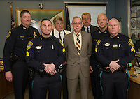 Laconia Police Department promotions awarded during Police Commissioners meeting at Laconia City Hall Thursday afternoon.  (l-r) front row Detective Benjamin Black, Commissioner Armand Maheux, Detective Kevin Butler.  (l-r) back row Detective Sergeant Thomas Swett, Commissioner Douglas Whittum, Commissioner Thomas Tarr and Chief Chris Adams.  (Karen Bobotas/for the Laconia Daily Sun)