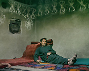 Man resting in a Wakhi home. Aziz Baig. House of Khalifa Azim. The traditional life of the Wakhi people, in the Wakhan corridor, amongst the Pamir mountains.