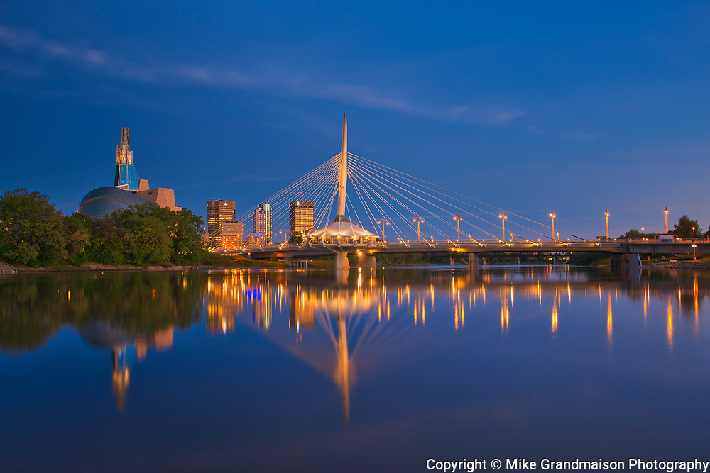 WInnipeg City skyline reflected in the Red River at dawn<br />Winnipeg<br />Manitoba<br />Canada