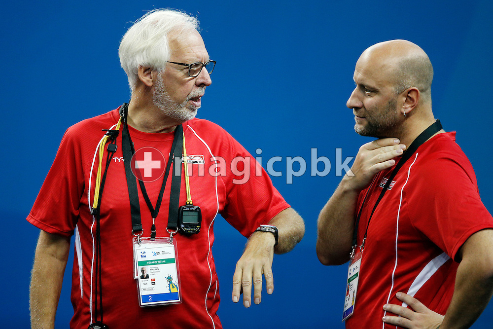 Swiss Swimming coaches Flemming POULSEN (L) and Dirk REINICKE talk to each other during a training session 2 days prior to the start of the 12th Fina World Short Course Swimming Championships held at the Hamad Aquatic Centre in Doha, Qatar, Monday, Dec. 1, 2014. (Photo by Patrick B. Kraemer / MAGICPBK)