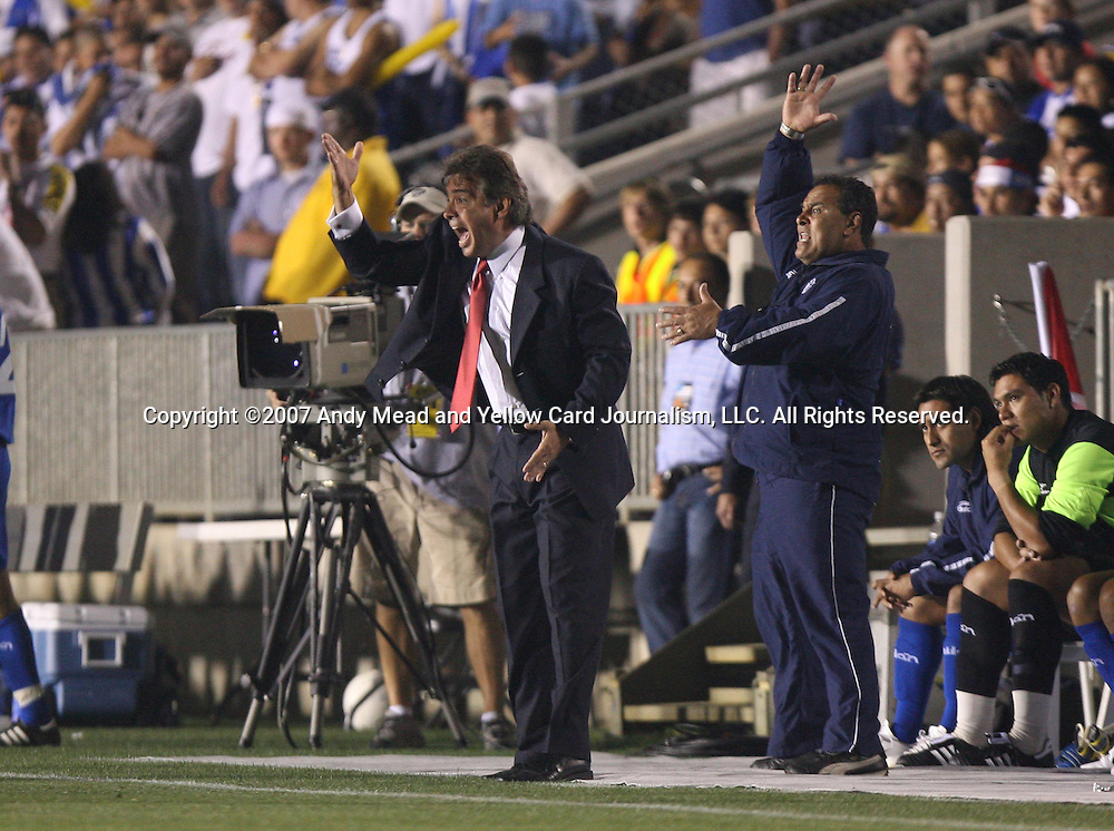 El Salvador head coach Carlos de los Cobos (l) yells at the referee on Tuesday, March 27th, 2007 at SAS Stadium in Cary, North Carolina. The Honduras Men's National Team defeated El Salvador 2-0 in a men's international friendly.