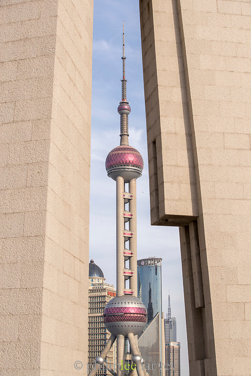 Cityscape with view of the Monument to the Peoples Heroes and the futuristic Oriental Pearl Tower, the Bund, Shanghai, China