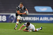 Rhys Webb of the Ospreys evades the tackle from Remi Lamerat of Clermont Auvergne (r). . European Rugby Champions Cup, pool 2 match, Ospreys v ASM Clermont Auvergne at the Liberty Stadium in Swansea, South Wales on Sunday 15th October 2017.<br /> pic by  Andrew Orchard, Andrew Orchard sports photography.