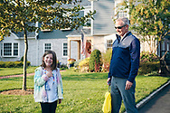 Rockville Centre, New York, U.S. September 22, 2020. L-R, MAEVE SCHIELE, 7, and her father BRIAN SCHIELE are outside their home, in which Ruth Bader and Martin Ginsburg were married in 1954. The Schiele family bought the Colonial home in Rockville Centre, Long Island, in 2016, from Martin Ginsburg's sister and brother-in-law, Claire and Edward Steipleman.