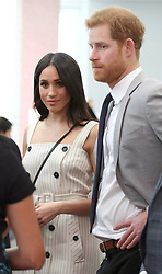 Prince Harry and Meghan Markle during a reception for delegates from the Commonwealth Youth Forum at the Queen Elizabeth II Conference Centre, London, during the Commonwealth Heads of Government Meeting.
