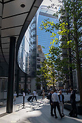 In the week that many more Londoners returned to their office workplaces after the Covid pandemic, workers sit and walk through September sunshine on Lime Street in the City of London, the capitals financial district, on 8th September 2021, in London, England.