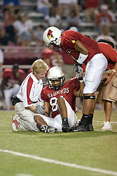 24 SEP 2005<br /> <br /> Illinois State Redbird training staff and Pierre Jackson help Wide Receiver Laurent Robinson to his feet after he is injured on a pass reception attempt.<br /> <br /> Illinois State University Redbirds are victorious with a shut out score of 42 - 0 over Murray State Racers during the Hall of Fame Game held at Hancock Stadium on Illinois State University campus in Normal IL