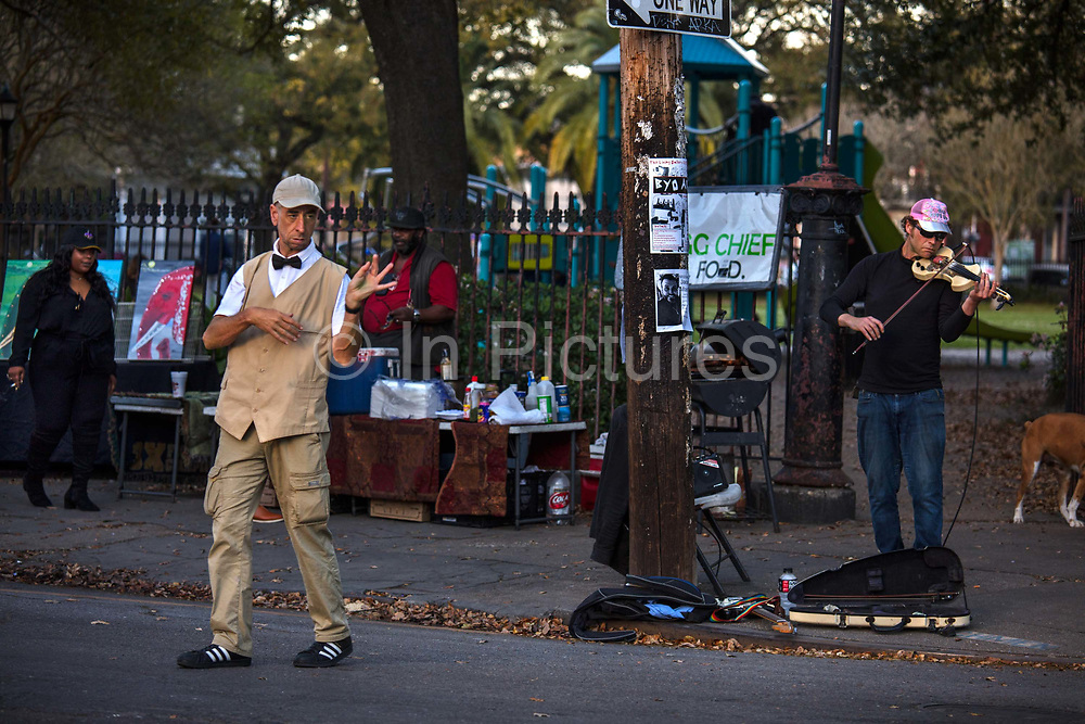 Man dancing on a street corner in the French Quarter on 11th March 2020 in New Orleans, Louisiana, United States.