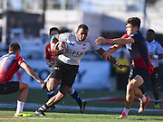Fijian player Paula Dranisinikula looks to break two Russian  tackles in the game Fiji vs Russia  during the USA Sevens Rugby Series at Sam Boyd Stadium, Las Vegas, USA on 2 March 2018. Picture by Ian  Muir.