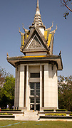 Buddhist Stupa at Choeung Ek, which is the site of a former orchard and mass grave of victims of the Khmer Rouge – killed between 1975 and 1979 Phnom Penh, Cambodia. Best-known of the sites known as The Killing Fields