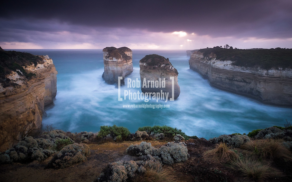 Two sea stacks (pillars), formerly connected and called Island Arch, along Australia's Great Ocean Road. The arch collapsed in 2009. The stacks are now called Tom and Eva after the two teenage survivors of the nearby Loch Ard shipwreck.