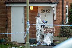 © Licensed to London News Pictures. 09/01/2020. Didcot, UK. A Police forensic investigator gathers evidence in the Mendip Heights estate where three men were injured during an incident and were taken to hospital for treatment. One of the men, aged in his forties was later pronounced dead and a murder investigation was launched. The victim received multiple stab wounds. Two other victims, one man in his twenties and another man in his thirties, are in serious but stable conditions in hospital. Photo credit: Peter Manning/LNP