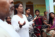 Neeta Shani, (centre) is speaking at an awareness workshop or youngsters organised by the charity PVCHR, in Parmandapur, a rural area near Varanasi, Uttar Pradesh, India.