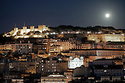 The Castelo de São Jorge looks particularly impressive in a full moon night from the walkway at the top of Elevador de Sta. Justa. This lift, built in 1902 with 45 metres tall, links the higher districts with Baixa in the hill directly opposite to the castle, in central Lisbon.
