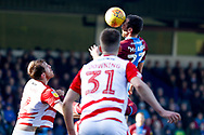 Scunthorpe United defender Rory McArdle (23) heads the ball during the EFL Sky Bet League 1 match between Scunthorpe United and Doncaster Rovers at Glanford Park, Scunthorpe, England on 23 February 2019.
