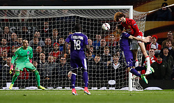 Manchester United's Marouane Fellaini (right) heads across goal for Paul Pogba (not pictured) to score but it is later ruled out for a foul by Fellaini during the UEFA Europa League, Quarter Final match at Old Trafford, Manchester.