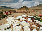 """Djer Qabtshal summer camp: """"Kurut"""" cheese drying in the sun for a few days, making it hard as stone and easy to preserve through winter, when yaks do not give any milk.<br /> <br /> Adventure through the Afghan Pamir mountains, among the Afghan Kyrgyz and into Pakistan's Karakoram mountains. July/August 2005. Afghanistan / Pakistan."""