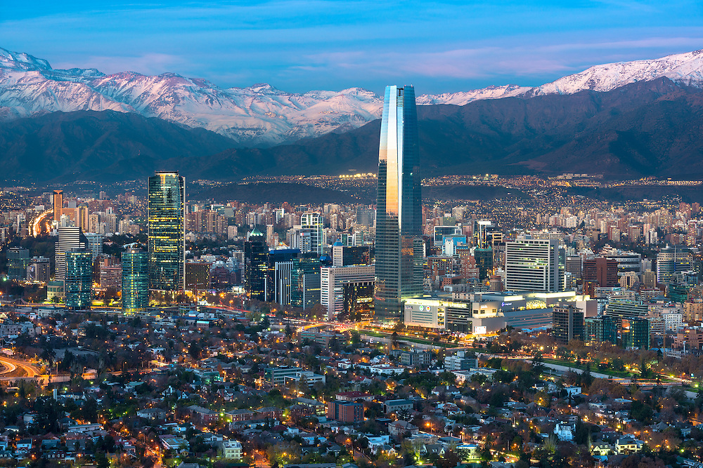Panoramic view of Providencia and Las Condes districts with Costanera Center skyscraper, Titanium Tower and Los Andes Mountain Range, Santiago de Chile <br /> <br /> For LICENSING and DOWNLOADING this image follow this link: http://www.masterfile.com/em/search/?keyword=600-06786893&affiliate_id=01242CH84GH28J12OOY4<br /> <br /> For BUYING A PRINT of this image press the ADD TO CART button.<br /> <br /> Download of this image is not available at this site, please follow the link above.