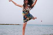 Israel, Tel Aviv, Teen Aged girl of 14 dancing on the beach