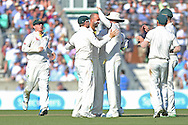 Nathan Lyon of Australia is congratulated after the wicket of Ben Stokes of England  during the 3rd day of the Investec Ashes Test match between England and Australia at the Oval, London, United Kingdom on 22 August 2015. Photo by Phil Duncan.