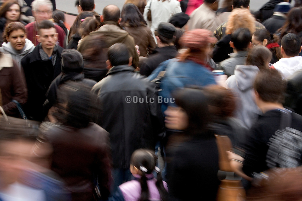 crowded sidewalk in Mid Town Manhattan New York City