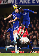 Gary Cahill of Chelsea and Tiemoue Bakayoko of Chelsea (r) clash heads as they both jump for a header .Premier league match, Chelsea v Manchester United at Stamford Bridge in London on Sunday 5th November 2017.<br /> pic by Andrew Orchard sports photography.