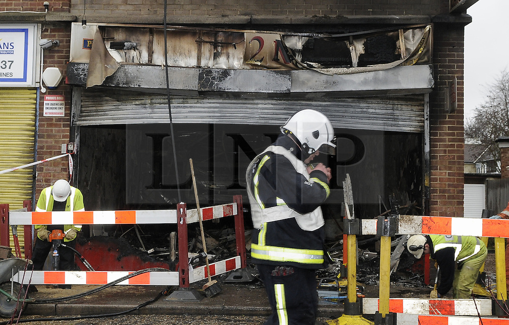 © Licensed to London News Pictures. 01/02/2013.A restuarant fire in Sidcup early this morning (01.02.2013) forced 21 people to flee the scene.Firefighters tackled the blaze in the ground floor of a maisonette in St James Way after a call at 4.30am.The Pizza 2 Night restaurant was severely damaged along with a large part of the first floor but no injuries were reported. Eight fire engines and 58 firefighters from Plumstead, Erith, Bexley, Eltham, Sidcup, Bromley,Peckham and Orpington fire stations attended scene....Photo credit : Grant Falvey/LNP