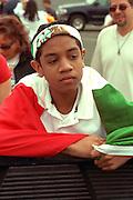Cinco de Mayo spectator  age 15 draped in Mexican flag.  St Paul Minnesota USA