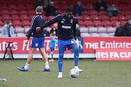 AFC Wimbledon attacker Michael Folivi (41) warming up during the The FA Cup 5th round match between AFC Wimbledon and Millwall at the Cherry Red Records Stadium, Kingston, England on 16 February 2019.