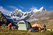 """Morning tents at Tuctucpampa campground below Nevado Jirishanca (left, """"Icy Beak of the Hummingbird"""" 6094 m) and Rondoy (right 5870 m). Day 2 of 9 days trekking around the Cordillera Huayhuash, in the Andes Mountains, Peru, South America."""