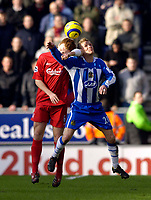 Photo: Jed Wee.<br />Wigan Athletic v Liverpool. The Barclays Premiership. 11/02/2006.<br />Liverpool's John Arne Riise (L) challenges Wigan's Gary Teale for possession.