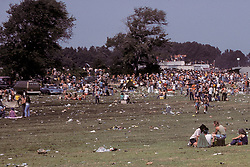 People On the Way to Experience The Grateful Dead Concert at Raceway Park, Englishtown NJ on 3 September 1977. Labor Day Weekend and on The Road into the Show. This shot taken outside the venue leading up to a gate on the west side. Cropped from the original format.
