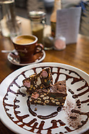A cup of coffee and cake in a cafe