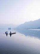 Fishermen in shikaras, a local wooden boad, on Lake Dal, India