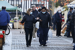 © Licensed to London News Pictures. 17/12/2020. Leatherhead, UK. Shoppers are seen in Leatherhead High Street in central Surrey. All of Surrey, except Waverley, will move from tier 2 to tier 3 restrictions on Saturday as Covid-19 cases rise. Photo credit: Peter Macdiarmid/LNP