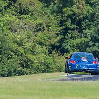 Alton, VA - Aug 26, 2016:  Rebel Rock Racing Borla Urban Grid Porsche Cayman races through the turns at the Oak Tree Grand Prix at Virginia International Raceway in Alton, VA.