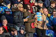 AFC Wimbledon fans holding Kick it out signs during the EFL Sky Bet League 1 match between AFC Wimbledon and Peterborough United at the Cherry Red Records Stadium, Kingston, England on 18 January 2020.