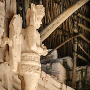 "Carved statue of a winged warrior on the exterior of the Tomb of Ukit Kan Le'k Tok' on top of the Acropolis on the northern side of the Ek'Balam archeological site on Mexico's Yucatan Peninsula. It was once a thriving city of Maya Civilization dating to the Late Classic period. It is 30km north of Valladolid and is named for ""Black Jaguar"" a distinctive motif throughout the site."